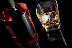 Top of view of whiskey with ice in glass on black background Stock Image
