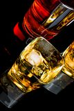 Top of view of whiskey with ice in two glasses on black background Royalty Free Stock Image