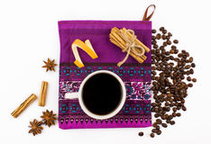 Top view, white background, cup of coffee, coffee beans, spices, cinnamon, sheet Stock Photos