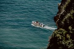 Top view of a white boat sailing in the ocean stock photos