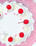 Top view of white cake with cherry topping Stock Image