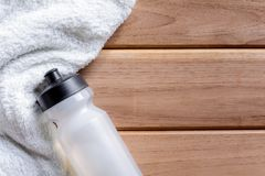 top view white cloth and plastic water bottle on wooden table Royalty Free Stock Image