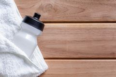 top view white cloth and plastic water bottle on wooden table Royalty Free Stock Photo
