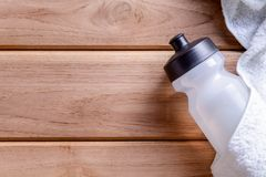 top view white cloth and plastic water bottle on wooden table Royalty Free Stock Photography