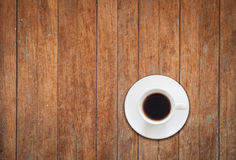 Top view of white coffee cup on wooden background Royalty Free Stock Photo