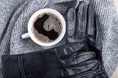 Top view of a white cup of coffee and gray woolen scarf Stock Images