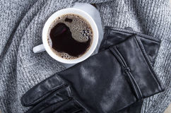 Top view of a white cup with coffee and gray woolen scarf Stock Images