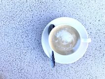 A cup of coffee. Top view white cup of coffee on table. Copy space for word or text Royalty Free Stock Photo