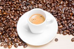 Top of view of white cup with espresso coffee near coffee beans Stock Photography