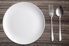 Top view White dish spoon fork on wood background Stock Image