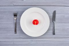 Top view of white dish with tomato Royalty Free Stock Photos