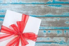 Top view of white gift box and red ribbon Royalty Free Stock Images