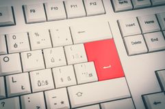 Top view of white keyboard with red Enter button - retro style. Top view of white keyboard with red Enter button - cyber crime concept - retro style Stock Images