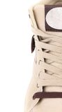 Top view of white laces sneakers. Royalty Free Stock Photos