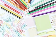 White desk with colorful supplies. Top view of white office desk with colorful supplies. Art, school and design concept Royalty Free Stock Photos