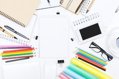 White desk top with empty notepad Royalty Free Stock Photos