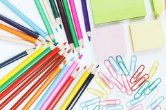 White table with colorful supplies. Top view of white office table with colorful supplies. Art, school and design concept Royalty Free Stock Photo