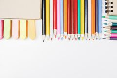 White workspace with colorful supplies. Top view of white office workspace with colorful supplies. Art, school and design concept Stock Image