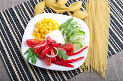 Top view of a white plate with slices of fresh vegetables Royalty Free Stock Images