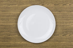 Top view of white plate on wood Stock Photography