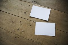 Top view of white postcard or papers on old wooden background royalty free stock images