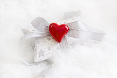 Top view of white and silver present box with red heart for chri Stock Image