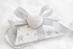Top view of white and silver present box with white heart for ch Stock Photography