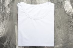 Top view of a white T-shirt on a dark background, mocap royalty free stock photos