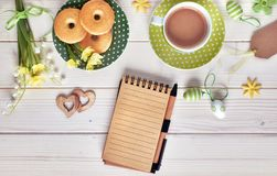 Top view on white wooden table with espresso cup, plate of cooki Royalty Free Stock Photography