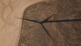 Top view of windmill shadow over cultivated land stock video footage