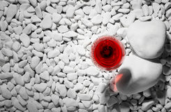 Top view of a wine glass. Red bordeaux in a glass on a gray background. Alcoholic wine on white rocks. Winery concept. A top view of a glass of red wine on Royalty Free Stock Image