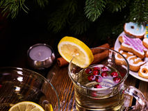 Top view of wine glasses part and Christmas cookies . Stock Images