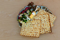Top view  wine and matzoh jewish passover bread over wooden background. Royalty Free Stock Image