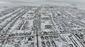 Top view of a winter village. The rural settlement is covered with snow. Snow and winter in the village.  stock video