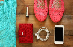 Top view of woman accessories collection over wooden background Stock Image