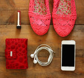 Top view of woman accessories collection over wooden background Royalty Free Stock Image