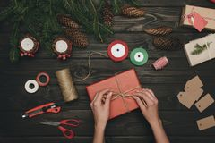 Woman decorating christmas gift Royalty Free Stock Photo