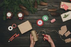 Woman decorating christmas gift Stock Photos