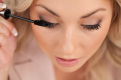 Top view of woman doing make-up Royalty Free Stock Images