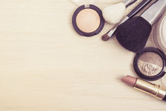 Top view of woman earth tone cosmetics. Vintage Tone Stock Photography