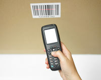 Top view of woman hand holding bar code scanner   Stock Photo