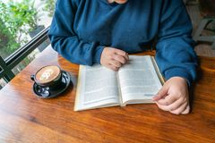Top view of woman hand reading book stock image