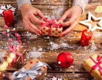 Top view of woman hands with gift box. stock image