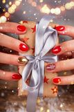 Top view of woman hands with gift box. stock images