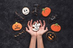 Woman holding halloween cookie Royalty Free Stock Photos