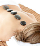 Top view of a woman with hot stones on her back Stock Image