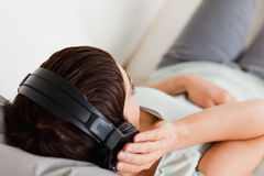 Top view of a woman listening to music Stock Image