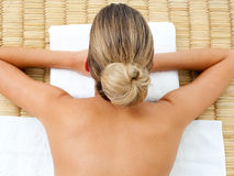 Top view of a woman lying in a massage table stock photo