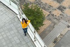 Top view of woman make a call from mobile phone Royalty Free Stock Images