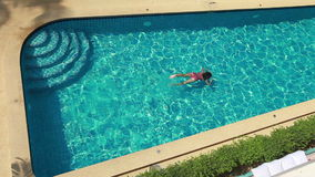 Top View Of Woman In Pool. Woman Swimming Underwater In Blue Swimming Pool. Top View stock video footage